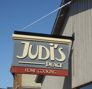 Signs By Benchmark Projecting Sign - Judi's Place