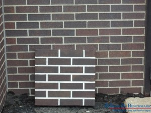 Signs By Benchmark faux brick panel matches original brick