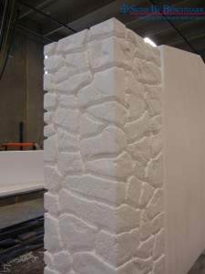 Custom faux stacked stone column for exterior sign under construction