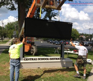 Toth's Sports installing integrated Signs By Benchmark monument sign
